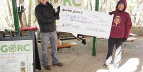 Alpine Shop Presenting check to GORC